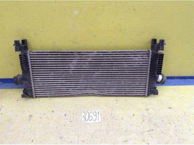 Opel Astra J радиатор интеркулера